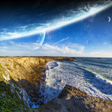View of distant planet system from cliffs Stock Images