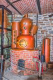 View into a distillery. Detail of copper plant for distilling schnapps royalty free stock photos