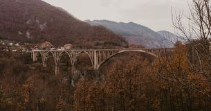 View of Djurdjevica bridge over the river Tara in Montenegro, Europe. Beautiful world of Mediterranean countries. Aerial panorama stock photography