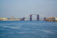 View of Dnieper river and the bridge from the coast of Kiev. Modern big city. Beautiful spring landscape stock image
