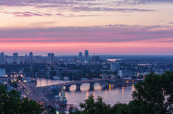 The view of the Dnieper river and bridge in Kyiv at sunset Royalty Free Stock Photo