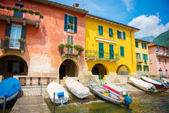 View of the dock and colorful buildings. Lake Como Royalty Free Stock Photography