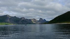 View from the dock to the beautiful fjord boat sails into the stock footage
