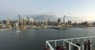 View from the dock to the buildings in New York, Tourists on the cruise ship having a good time and watching New York. Accelerated footage-USA-New York stock footage