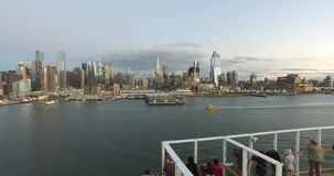 View from the dock to the buildings in New York, Tourists on the cruise ship having a good time and watching New York stock video footage