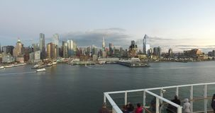 View from the dock to the buildings in New York, Tourists on the cruise ship having a good time and watching New York stock footage