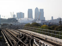 View from a Docklands Light Railway Station. Of Canary Wharf in Docklands and the Millennium Dome Stock Photography