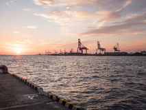 View of a dockyard at sunset Royalty Free Stock Photo