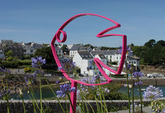 View of Doelan harbour with  and metal fish sculptures Stock Photography