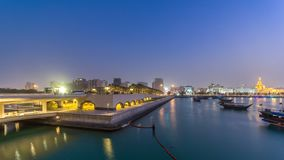 View of the Doha city in front of the Museum of Islamic Art day to night timelapse in the Qatari capital, Doha. View of the Doha city in front of the Museum of stock footage