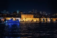 View of the Dolmabahche palace in beams of night-time lighting royalty free stock photos