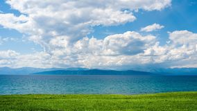 View of the Dolon Peninsula from the eastern shore of Lake Hovsgol, Mongolia. View of the Dolon Peninsula on a cloudy summer day from the eastern shore of Lake stock photos