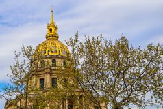 View on the Dome church of Les Invalides through trees in spring in Paris France. April 2019 royalty free stock photography