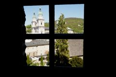 The window view at the dome of the Collegiate Church in Salzburg , Austria. The view at the dome of the Collegiate Church in Salzburg, Austria royalty free stock image