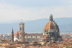 View of Dome in Florence with Torre di Giotto. Dome and Cuppola of Firenze with Torre di Giotto, in the back the Appenin Stock Photo