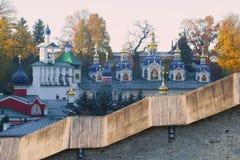 View of domes of the Svyato-Uspensky Pskovo-Pechorsky monastery in the October morning. Pechora, Pskov region. Russia Stock Photos