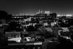 View of the Domino Sugars Factory and houses in Federal Hill at night, in Baltimore, Maryland stock photos