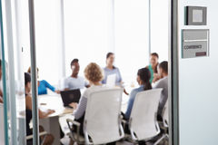 View Through Door Of Conference Room To Business Meeting Royalty Free Stock Photo