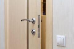 View of a door handle of an opened new door. Royalty Free Stock Image