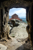 View through doorway in cave city Uplistsikhe. View through doorway to an old church in cave city Uplistsikhe, Georgia Royalty Free Stock Photo