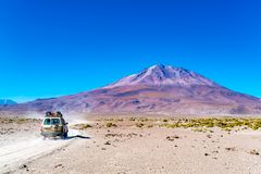 View of the dormant volcano Tunupa at the edge of the Uyuni Salt Flat in Bolivia. With the transportation stock image
