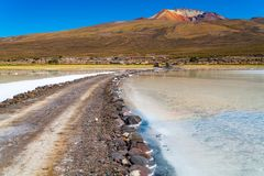 View of the dormant volcano Tunupa the village of Coqueza and the Uyuni Salt Flat. In Bolivia royalty free stock image