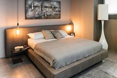 View of double bed in cozy interior stock images