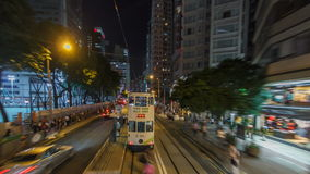 View from double-decker tram on street of HK timelapse hyperlapse. View from double-decker tram on street of HK timelapse hyperlapse drivelapse. Hong Kong stock video footage