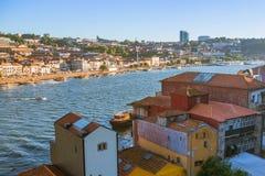 View of Douro river and coasts of Ribeira and of Vila Nova de Gaia. PORTO, PORTUGAL - JUL 9, 2016: View of Douro river and coasts of Ribeira and of Vila Nova de royalty free stock photos