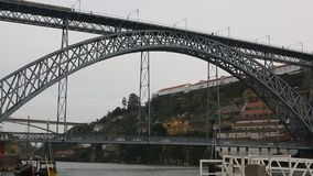 View of Douro river and Dom Luis I Bridge at center of Porto stock video footage