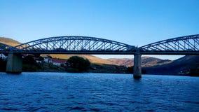 View from the Douro river to Pinhao Bridge and vilage in Portugal. Travel, landscape. Vista do Rio Douro da Ponte e Vila de Pinhão. Portugal stock photo