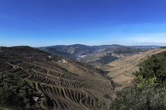 View of Douro Valley with the Pinhao village, terraced vineyards and the Douro River, in Portugal. Concept for travel in Portugal and most beautiful places in royalty free stock images