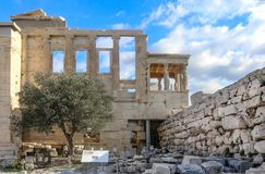 View from down below the Erechtheion - a temple dedicated to Athena and Poseidon-and the Porch of the Caryatidson on the Athens Ac stock image