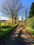View down empty country lane on beautiful Autumn day. Stock Photo