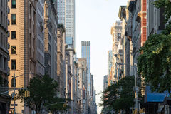 View down Fifth Avenue in Manhattan, New York City with historic. Buildings lining both sides of the street in NYC Royalty Free Stock Photography