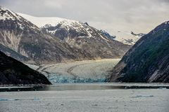 A view down a fjord to a stunning Glacier in Alaska. royalty free stock photography