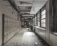 View down a hallway in an abandoned high school. With lockers lining the wall royalty free stock photos