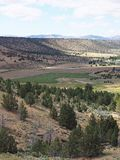 Valley down below. A view down hills into the farming valley and the small rural community of Gateway in Central Oregon on a sunny summer  day royalty free stock photography