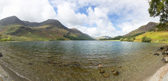View down length of Buttermere in Lake District. Buttermere lake in Lake District in England looking down length of the water Royalty Free Stock Photography