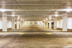 View down the length of an empty parking garage Royalty Free Stock Photography
