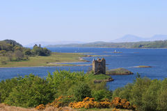 View down Loch Linnhe past Castle Stalker to Mull Stock Image
