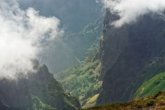 View down from mountain peak at a valley in the distant. Pico do Arieiro on Portuguese island of Madeira royalty free stock image