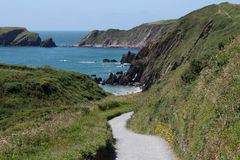 A view down the path to Marloes Sands, Pembrokeshire. A view down the path to Marloes Sands, Pembrokeshire with views of coastline and cliffs Stock Image