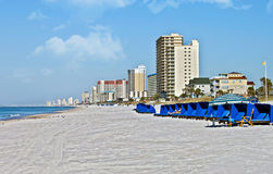 View Down a Quiet Beach. The shoreline of a beach at Panama City Beach, Florida Stock Photos