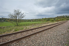 View down railway track in english countryside Royalty Free Stock Photography