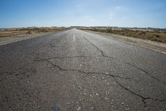 View down a remote desert road Royalty Free Stock Image