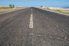 View down a remote desert road Royalty Free Stock Images