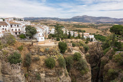 View down the steep rockface to valley in Ronda Stock Photography