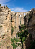 View down the steep rockface to valley in Ronda Stock Image