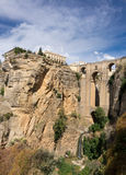 View down the steep rockface to valley in Ronda Royalty Free Stock Photo